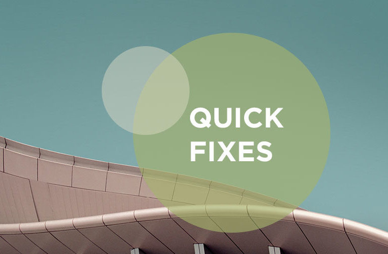 quick fixes text in green circle against landmark building